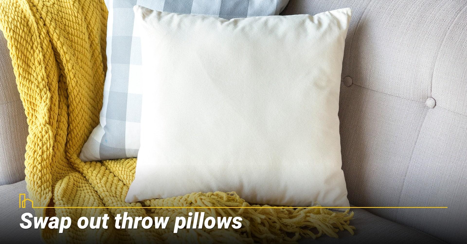 Swap out throw pillows, upgrade throws and pillows