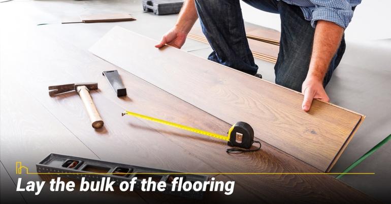 Lay the bulk of the flooring