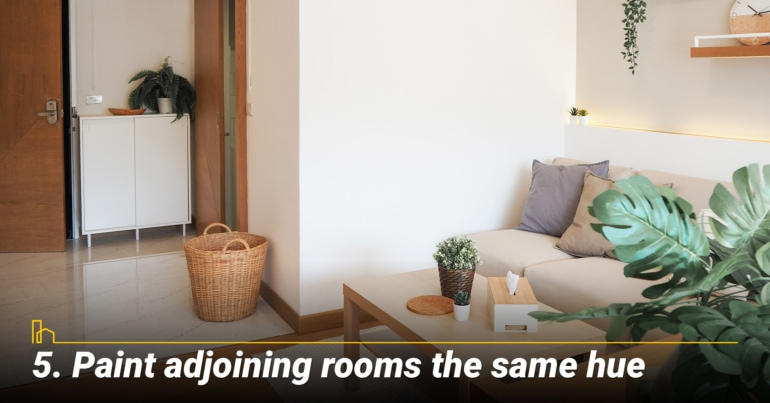 Paint adjoining rooms the same hue